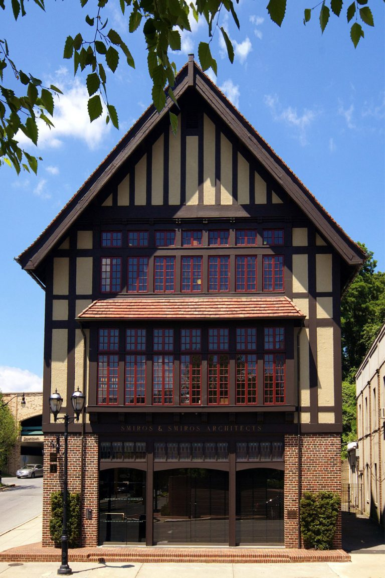 Photograph of the Street-side view of the Studio, tudor style, old Glen Cove post office renovation, stucco