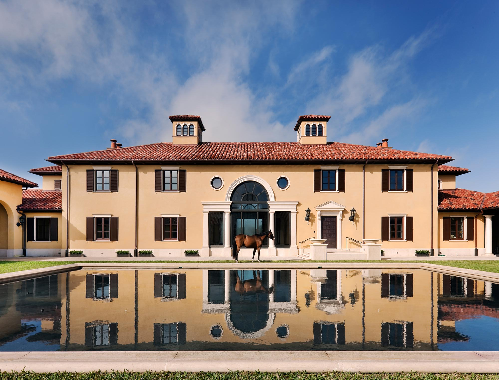 Wellington Florida, reflecting pool with horse, Mediterranean style, Spanish style, Palladian, clay terracotta roof tile, stucco