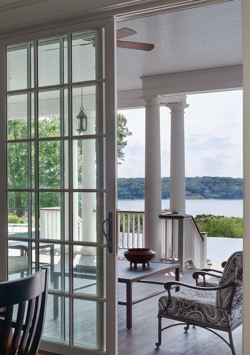 Queen Anne Revival, Cold Spring Harbor, long island, water view, long island sound, patio, deck, doric columns, ceiling fan, infinity pool, sliding door