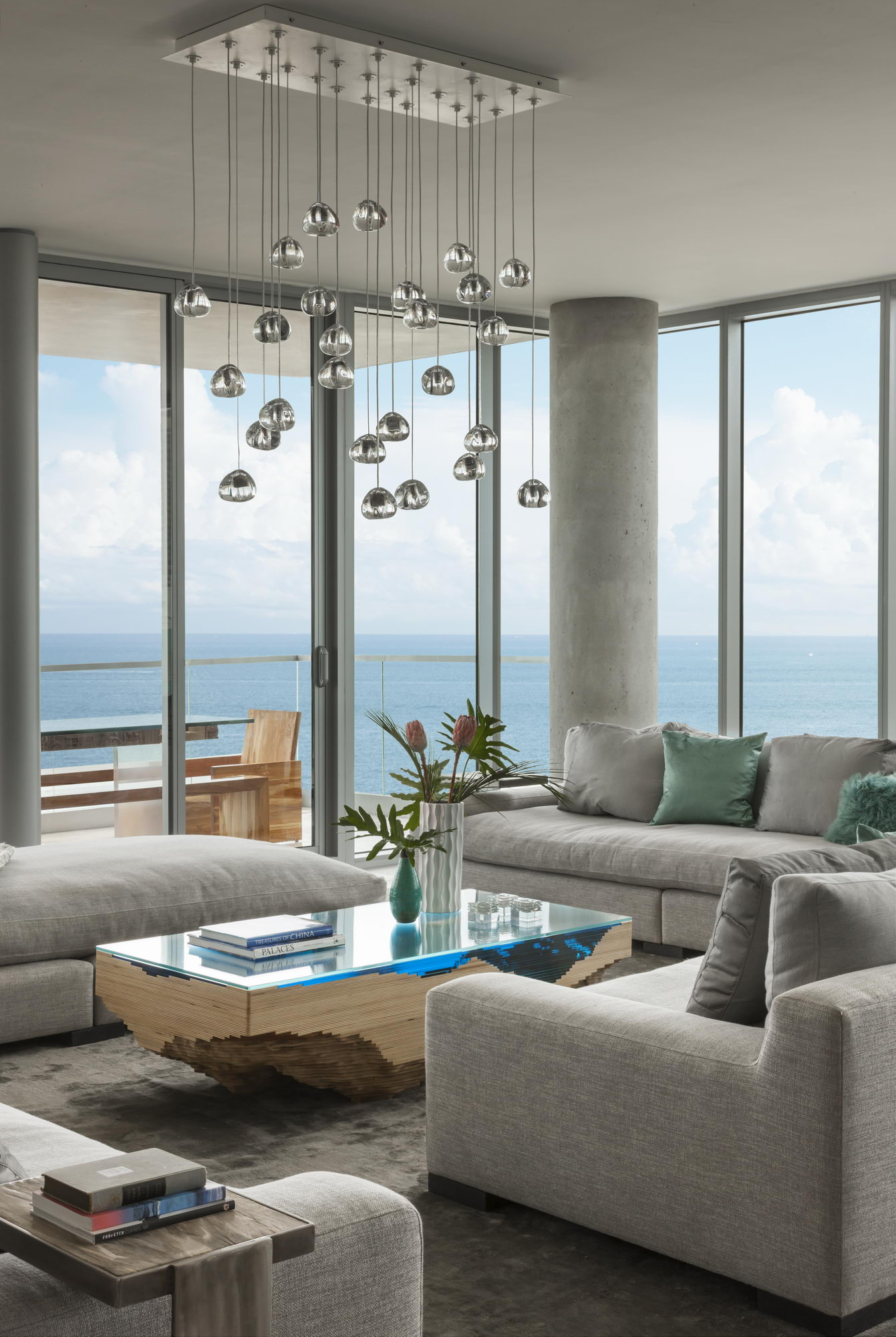 Ocean penthouse beach view south beach Miami Florida contemporary apartment living room family topographic table balcony picture windows chandelier