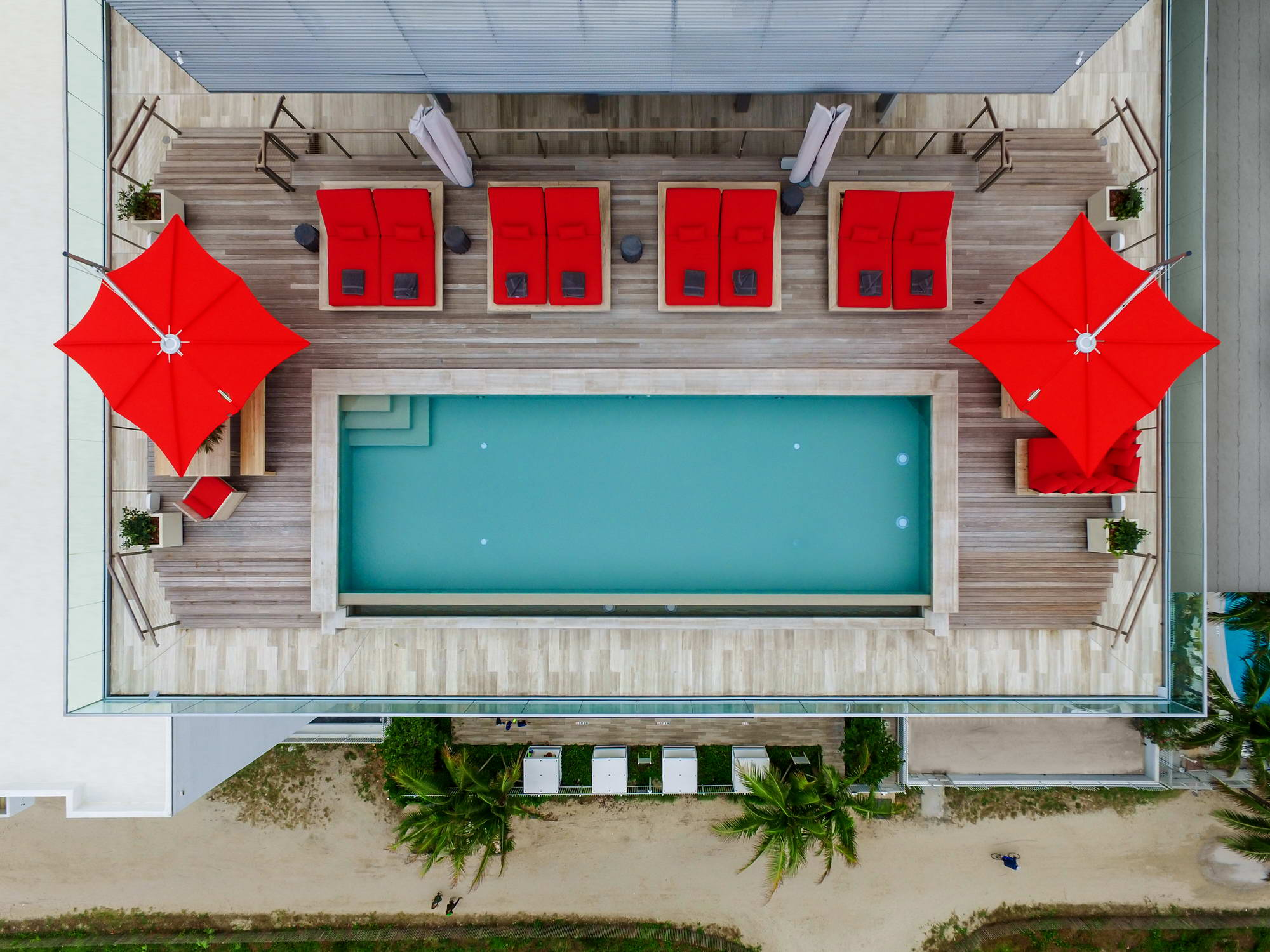 Ocean penthouse beach view south beach Miami Florida contemporary apartment aerial exterior infinity pool lounge chairs terrace deck roof
