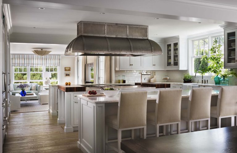 East Hampton, Long Island architect, classical, traditional, transitional interiors, neoclassical, renovation, kitchen, butcher block carving, family room, metal stove hood